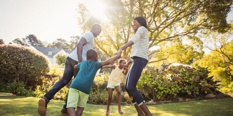 family playing in the yard