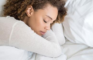 woman laying in comfy bed